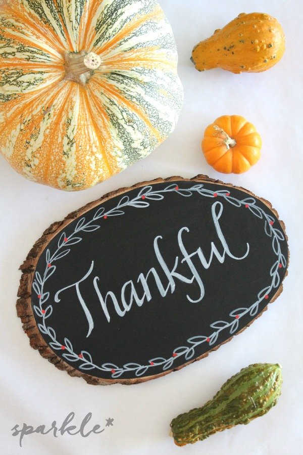 Create a rustic looking chalkboard on a wooden plank. It makes a perfect homemade hostess gift for the holidays!