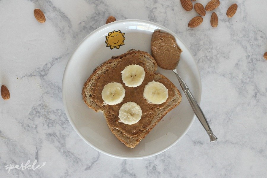 Easy peasy make your own almond butter. All you need is almonds, maybe a little sea salt and a blender.