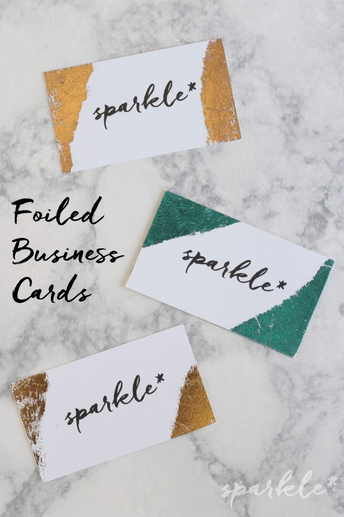 Take basic business cards and glam them up with shiny foil! The only supplies you need are DecoFoil, business cards and adhesive spray.
