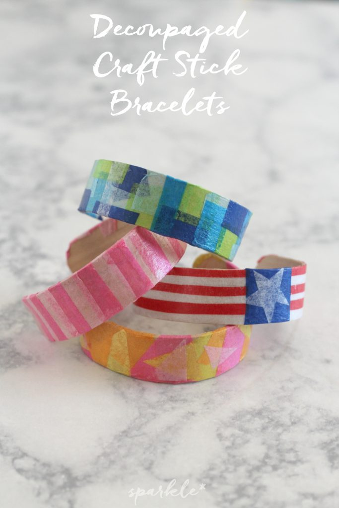 Need a fun craft to keep the kids busy for a bit this summer? Well these decoupaged craft stick bracelets might be just the thing.