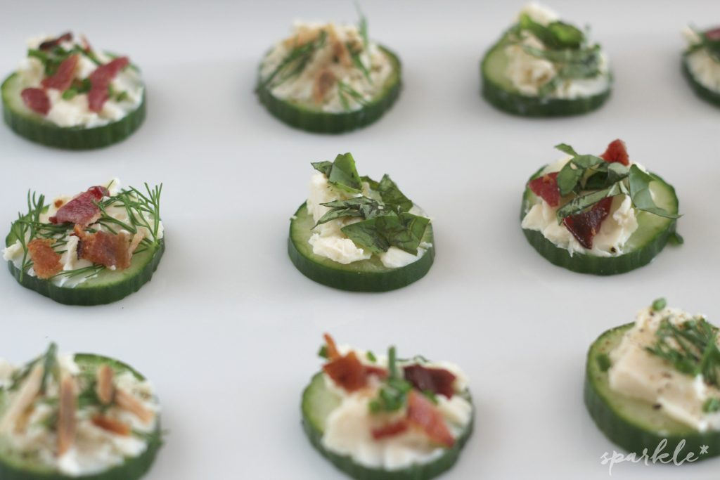 Creamy cheese on top of crisp cucumber topped with herbs and maybe some bacon? Sounds like a great snack to me!