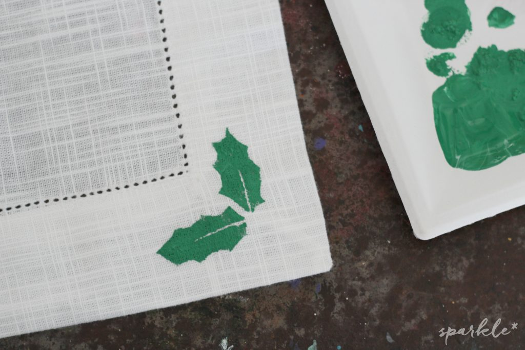 Holly Jolly Stenciled Table Runner and Dishtowels made with hand cut stencils. The stencils are so easy to cut and make your own!