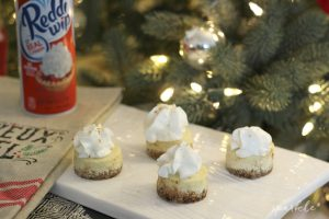 Mini eggnog cheesecakes with a gingersnap crust. Topped with some delicious Reddi-wip and try to eat just one!