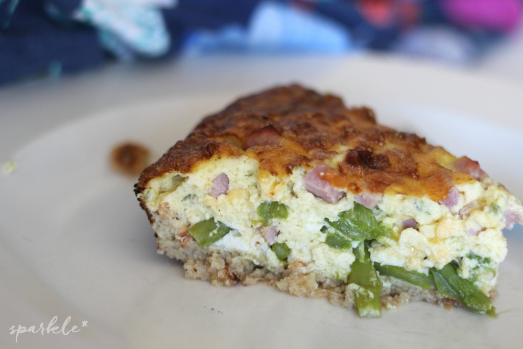 This low carb quiche, filled with ham, cheese and asparagus, has a flavorful cauliflower crust.