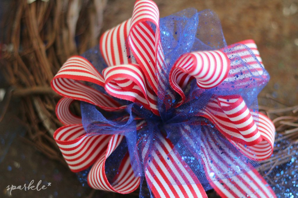 Quick and easy stars and stripes wreath. It's a perfect DIY tutorial for Memorial Day, 4th of July and Veteran's Day!