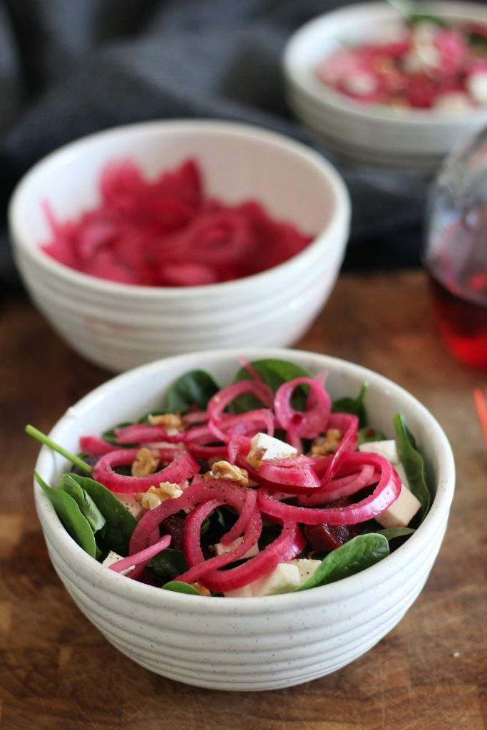 Beet and spinach salad with a red onion red wine vinaigrette.