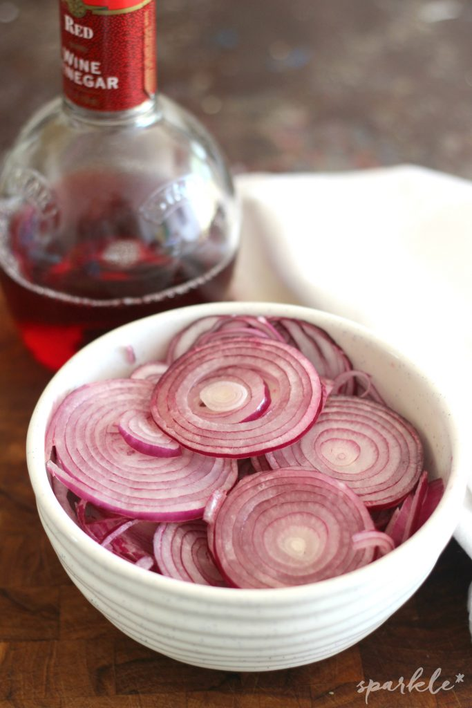 Pour the red wine vinegar on the onions for a tasty vinaigrette.