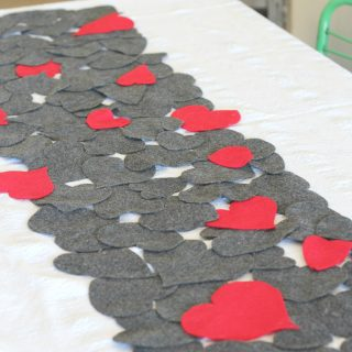 Mixed hearts Valentine's Day table runner made using felt and @spellbinders contour dies. It's a perfect craft for Valentine's decor!