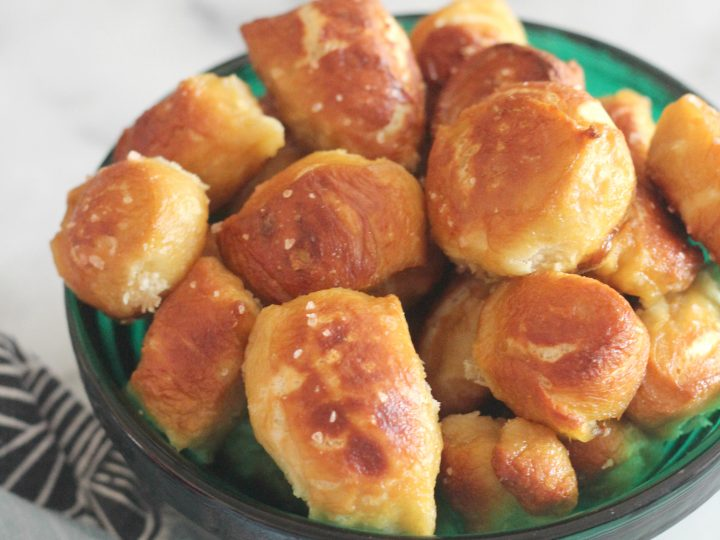 Don't be intimidated by these soft and chewy pretzel bites. They are easy to make at home and taste amazing! These bites are perfect as a party food or an after school snack!