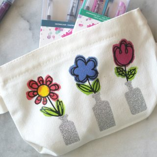 Make this Springtime Flower Pouch Craft in no time using Spellbinders dies, heat transfer vinyl and fabric paint!