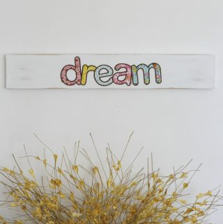 Create this super easy DIY fabric appliqué wooden sign with just a few simple supplies. This is a perfect handmade decor idea for a little girl's room! #woodensign #craft #DIY #fabriccraft