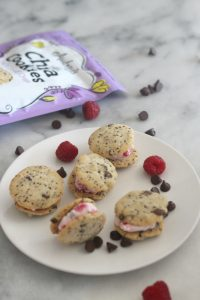 This recipe for Raspberry Chocolate Chip Frozen Yogurt Chia Cookie Sandwiches is so tasty and a healthier alternative to traditional ice cream sandwiches! We used Audrey's Chia cookies and they turned out amazint! #Ad #summertimetreats #frozensnacks #chia