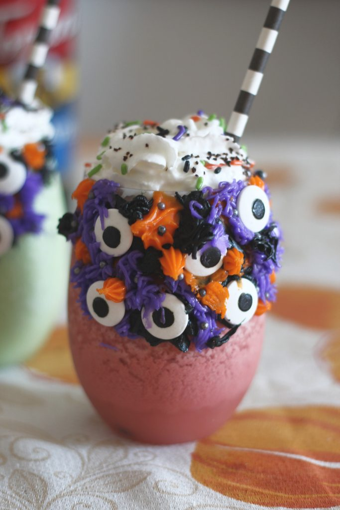 Create these fun and delicious Halloween frappés for your favorite kiddo! #mocktails #halloweendrinks #kidsdrinks #bloodorang #greenapple #torani