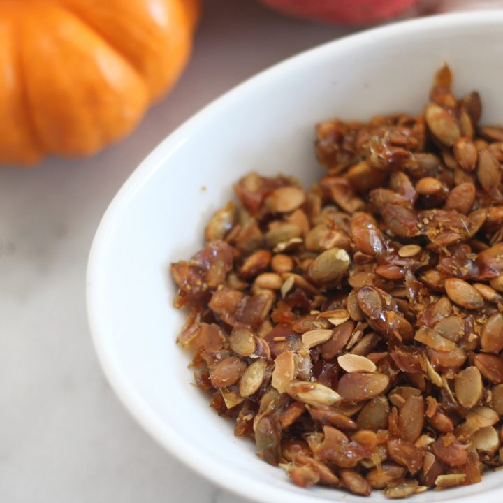 It only requires three ingredients and 15 minutes to make these delicious easy caramelized pepitas! #pumpkinseeds #fallbaking #salad #pepita