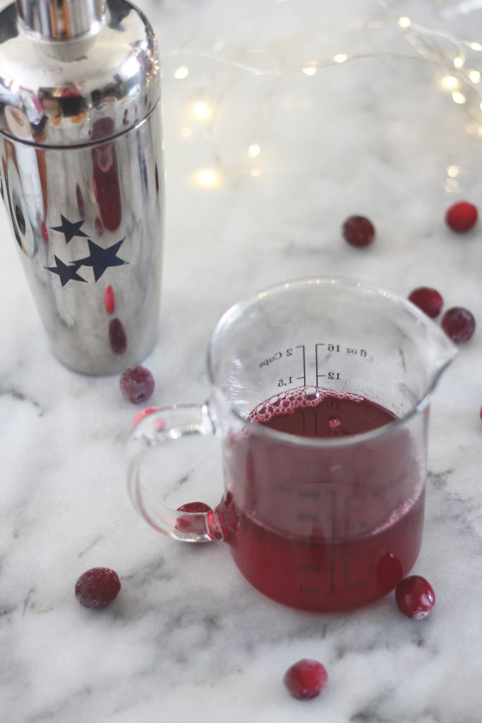 This super easy cranberry simple syrup recipe is perfect for adding flavor to your holiday cocktails and mocktails. #cranberry #simplesyrup #thanksgivingcocktails #christmascocktails #drinkrecipes #cranberry