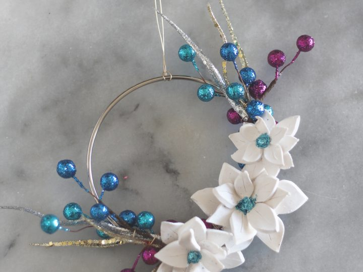 Mini Hoop Wreath Poinsettia Ornaments - modernize your Christmas tree with these little hoop wreath ornaments! They are glamorous and easy to make with this tutorial!