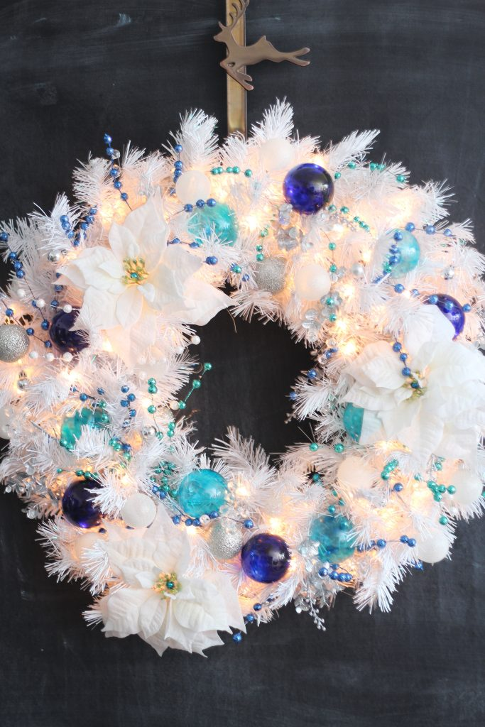 DIY turquoise and cobalt white Christmas wreath! This wreath is stunning to look at either unlit or with the gorgeous white lights! #Christmascrafts #christmaswreath #bluead whitechristmas #DIYwreath #sparklelivingblog