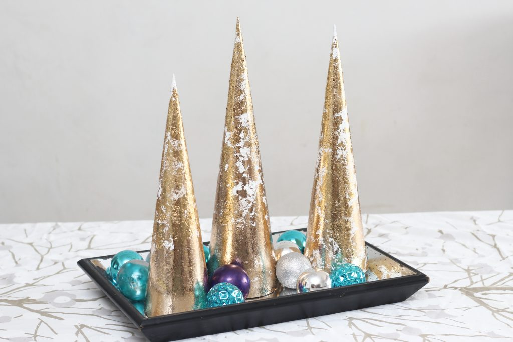 These gold leaf Christmas trees may look dramatic, but they are easy to make and are foolproof! #sparklelivingblog #christmascrafts #christmasdecor #goldleaf #christmastabledecore #tablescape