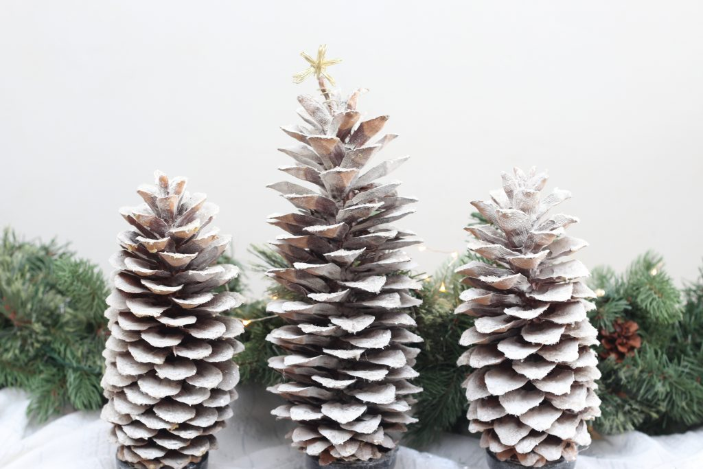 Find some pinecones and make these pinecone Christmas trees. It's a simple DIY that has a rustic, farmhouse look but can easily be made to fit your holiday decor! #christmascraft #simpleChristmascraft #easychristmas #naturalchristmas #rusticchristmas #farmhousechristmas