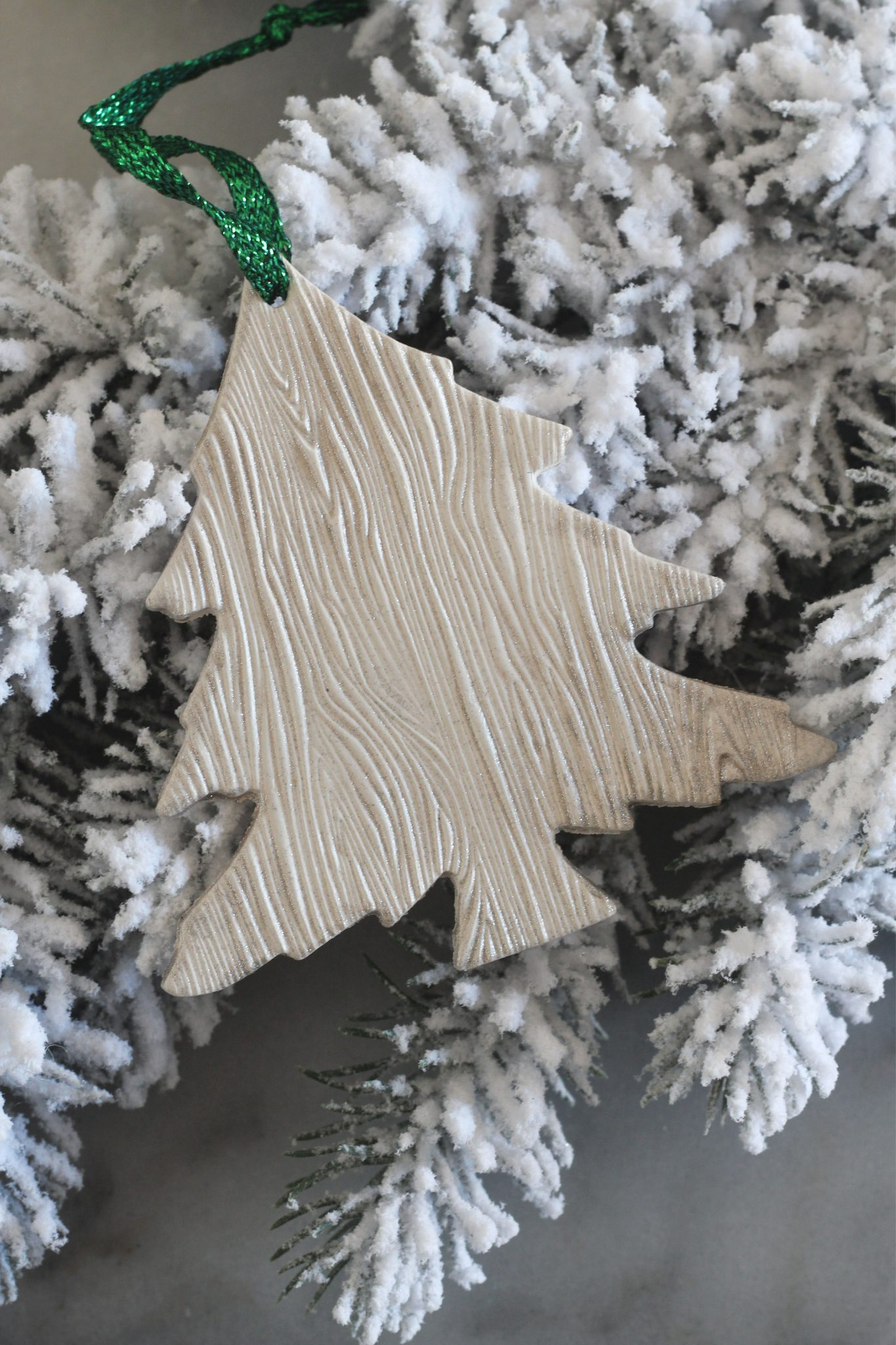 Woodgrain tree ornaments made from air-dry clay.