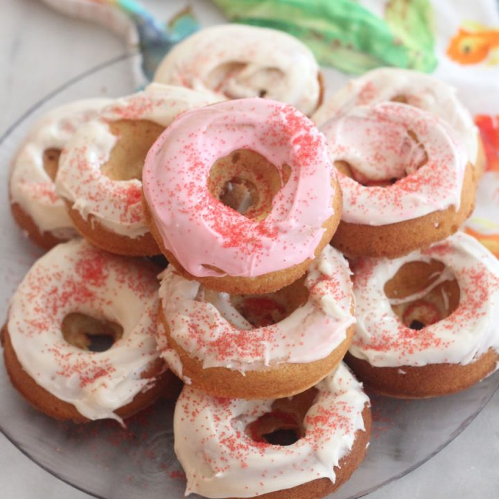 Treat your sweeties with these easy to make cake batter flavored baked donuts! This recipe is a fun twist on homemade baked donuts. #sparklelivingblog #bakeddonuts #makeyourownfood #dessertrecipes #sweettreats
