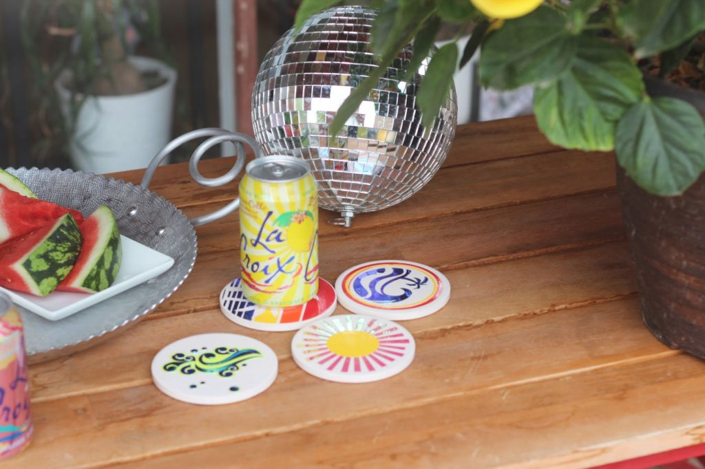 summer coasters on picnic table
