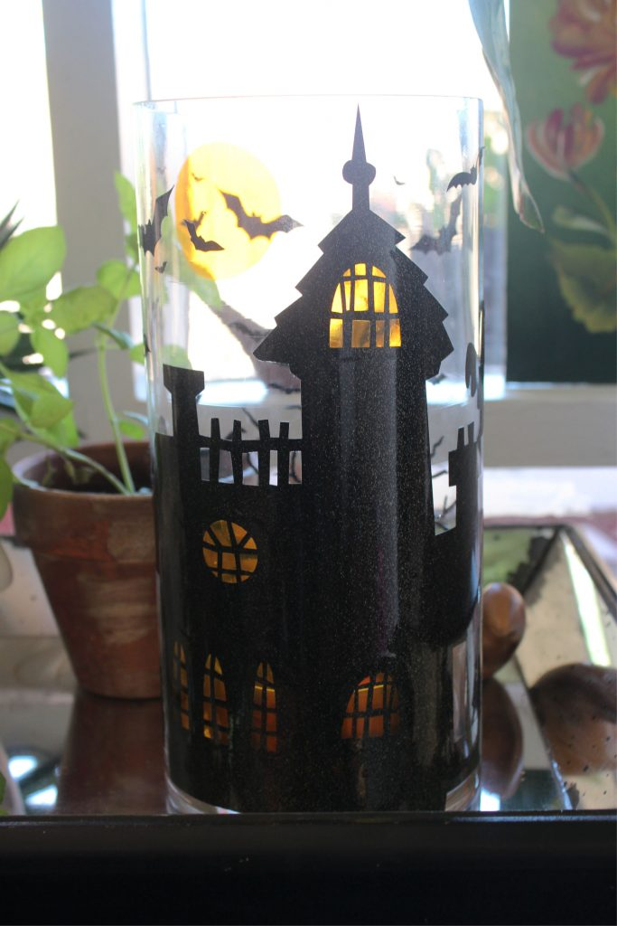 DIY Halloween Haunted House Pillar candle craft tutorial made with StyleTech Craft adhesive vinyl in Ultra FX Black Gold and Transparent vinyl.