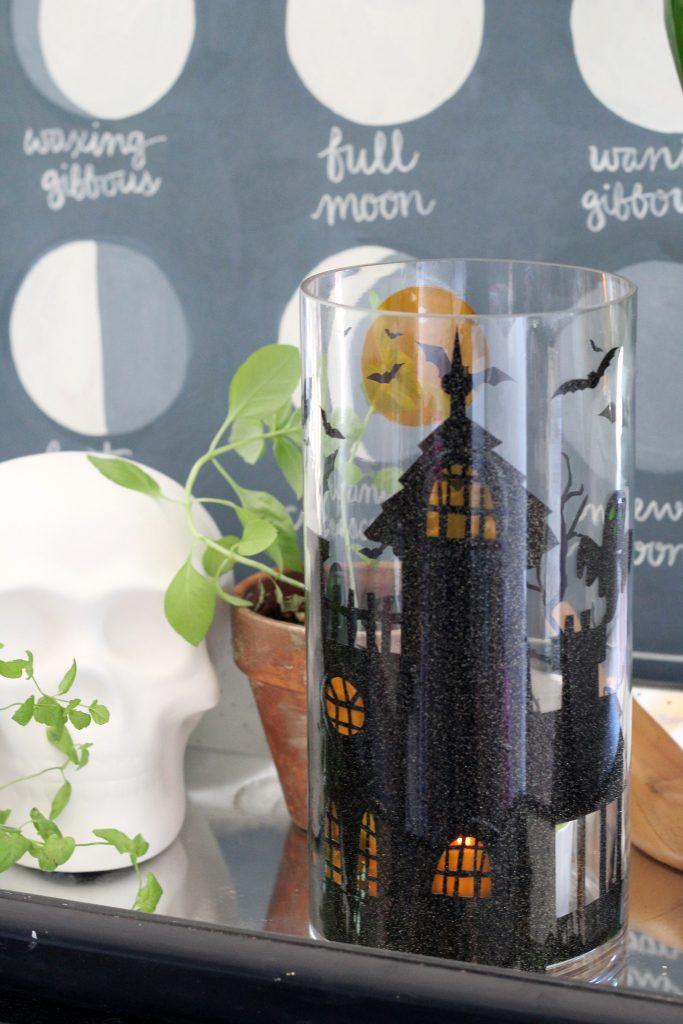 DIY Halloween Pillar Candle made with adhesive vinyl. Haunted House pillar candle.
