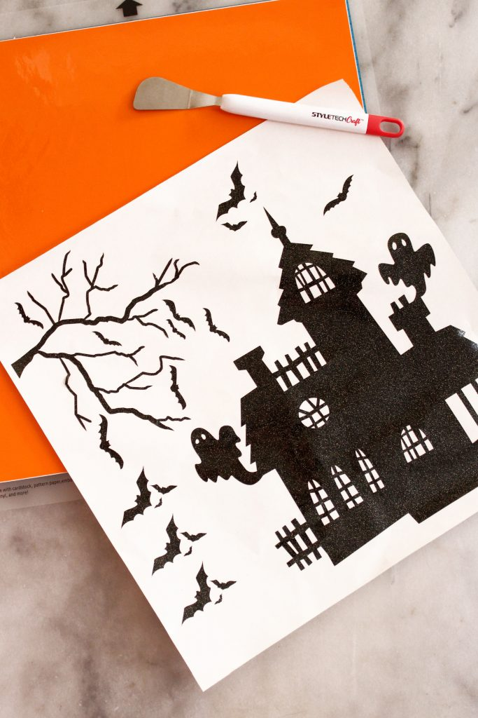 Adhesive vinyl from StyleTech Craft for Halloween Haunted House Pillar Candle Craft.