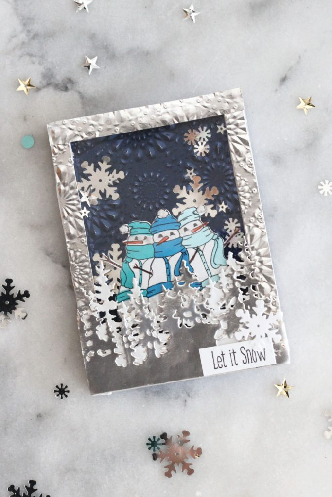 WInter wonderland shaker card with snowflake sequins and cozy snowmen.
