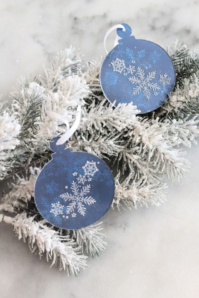 Stamped acrylic snowflake ornament with rinea foiled paper.