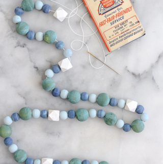 Wood bead garland in blue, green and white.