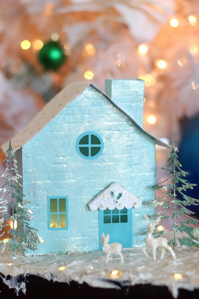Little House made of blue cardstock, with shimmering trees, glittered deer.