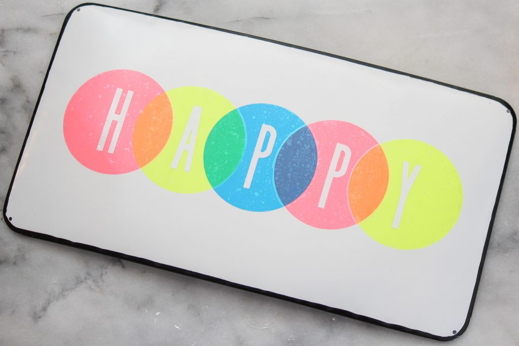 Colorful Vinyl Happy Sign on enamel