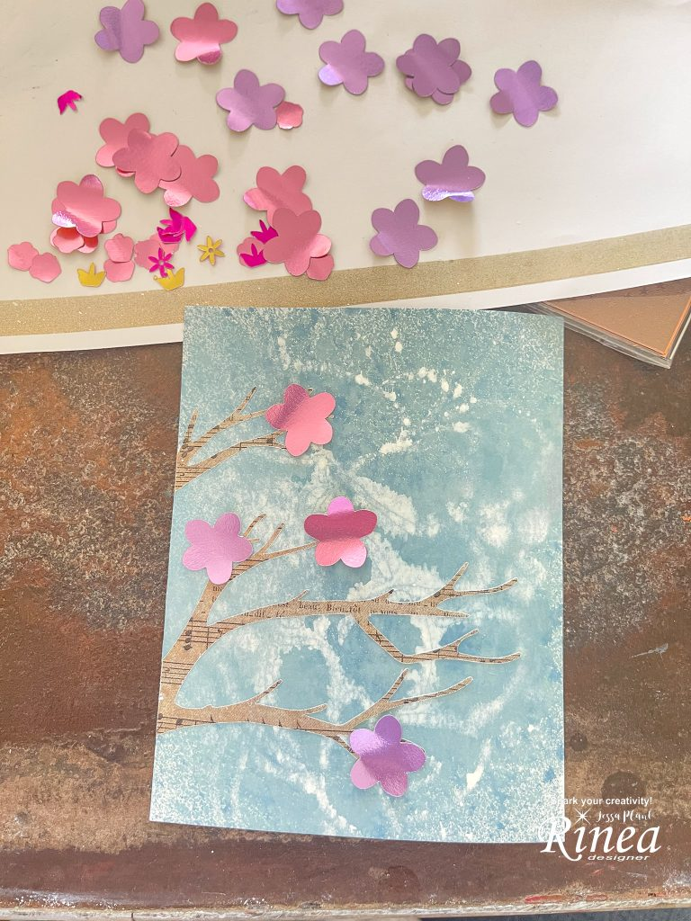 Image of cherry blossom card with cut outs of foiled paper flowers not yet glued on.