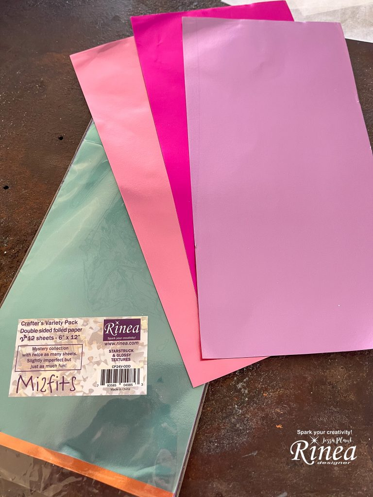Image of Rinea foiled papers in different tones of pink and a pack of Misfits foiled paper.