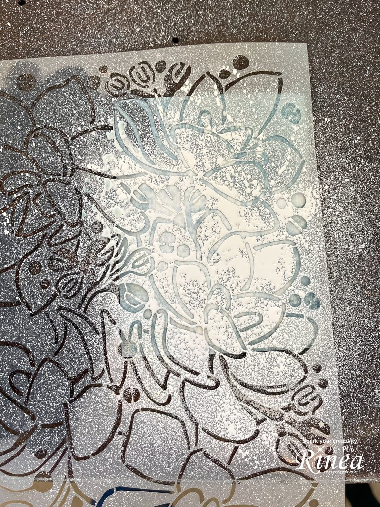 Image of stencil sprayed with white paint.
