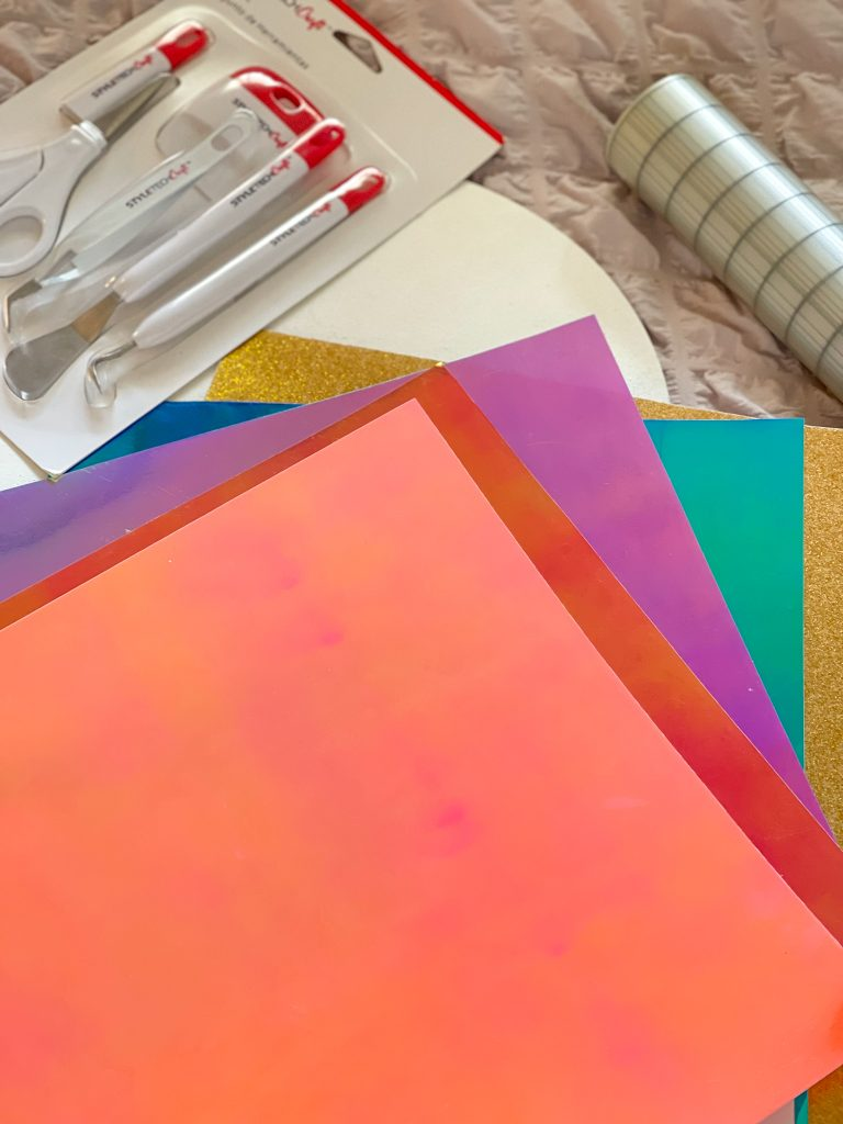 Image depicts opal vinyl, transfer tape and vinyl crafting tools.