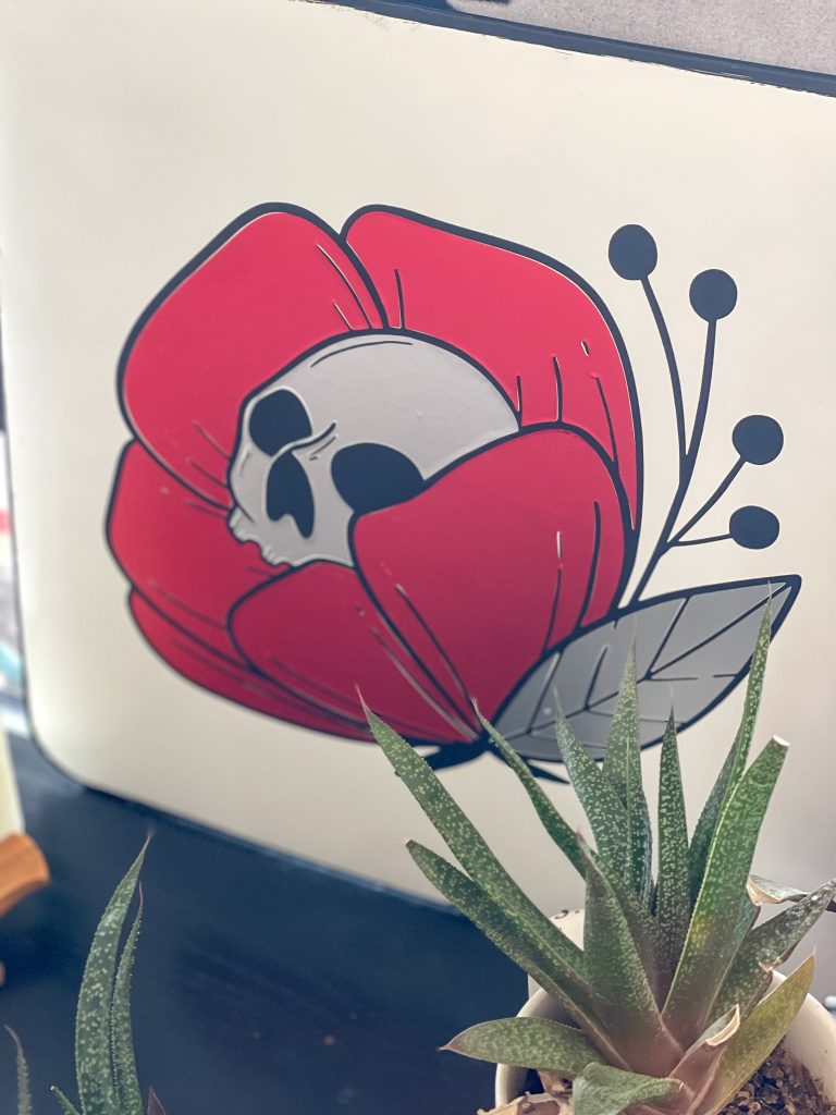 skull flower halloween sign on a black table